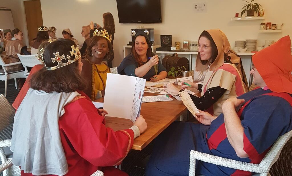 medieval murder mystery in costumes. Suspects, also queens of Britain are questioned by their subjects