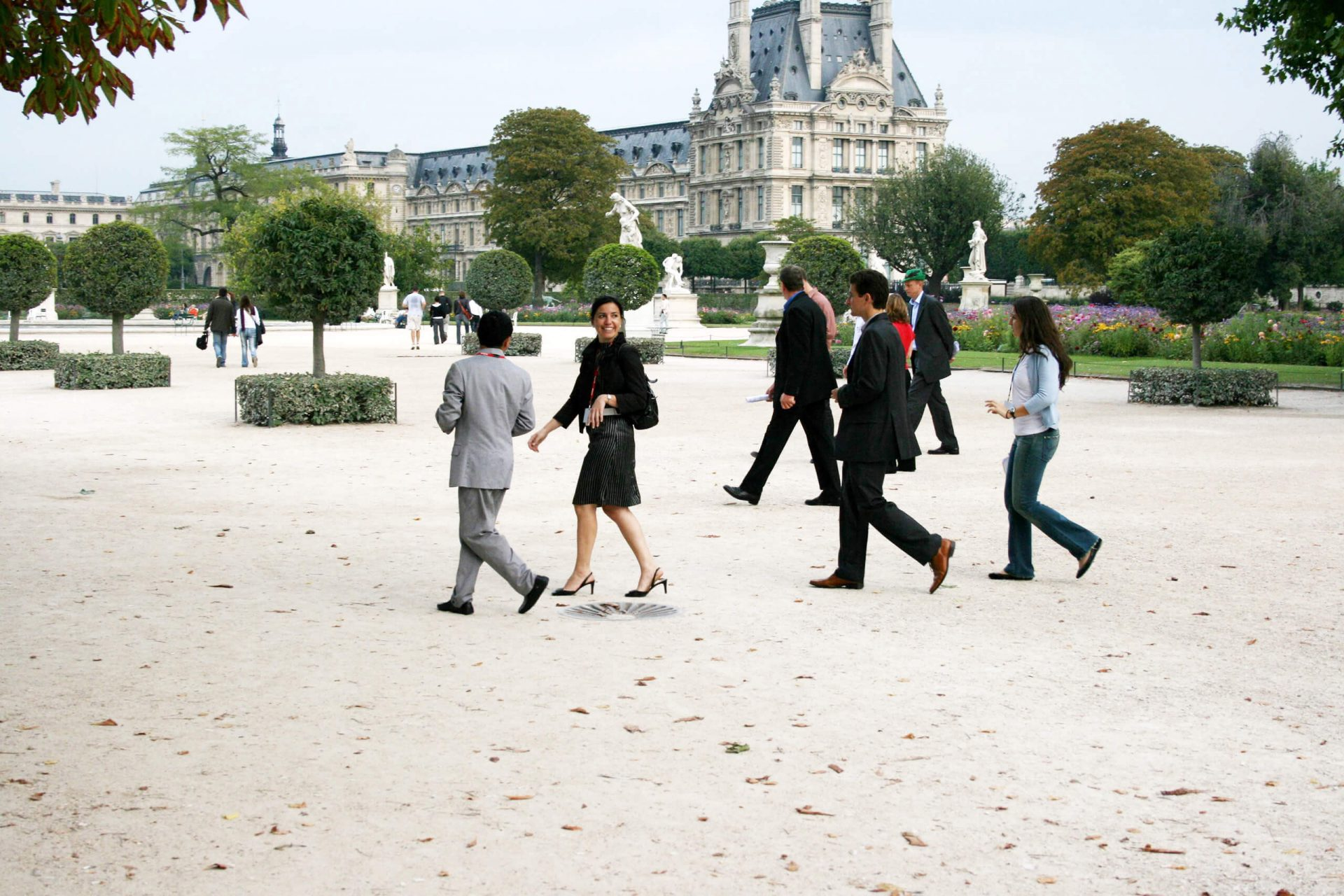 Team building rally, a team crosses the Tuileries Gardens towards the Louvre
