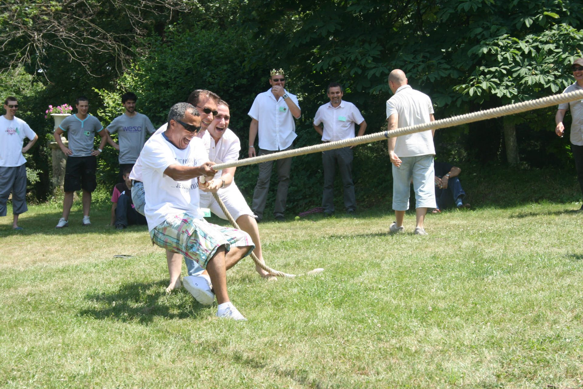 olympic games challenge of strength - tug of ware gardens of a chateau