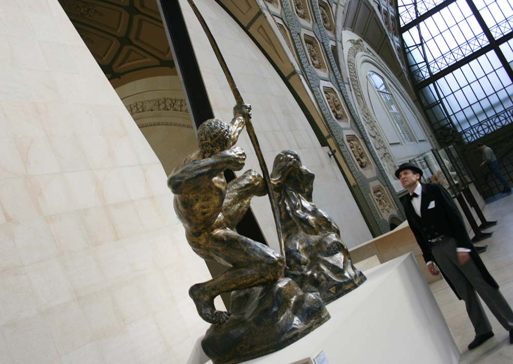 team building Paris Orsay Museum - Detective Poirot deep in thought before a statue of Hercules